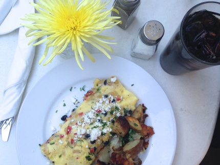 The 3 Sisters Omelet with corn, black beans, zucchini, mozz(arella), feta and spuds. Photo by Brooke Stobbe