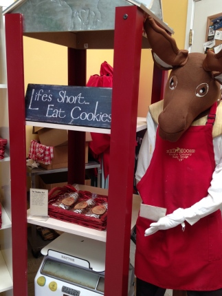 Cookies are sold in small bags of four, on display in red baskets. The mascot greets visitors when they first arrive. Photo by Brooke Stobbe