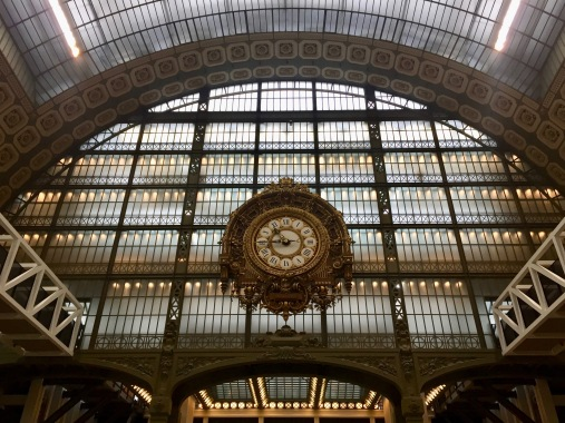Giant clock in the museum interior reminds visitors of the building's past as a bustling station.