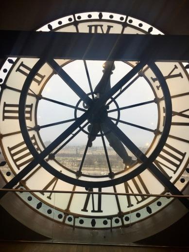 A beautiful of Paris through the museum's clocks.