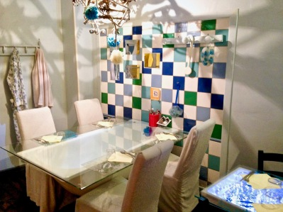 The bathroom was maybe my favorite, with glass propped over a tub filled with rubber ducks, and two-person table consisting of a small sink mounted to the wall with tube-sighing simulating running water underneath the glass top.