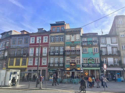 A welcoming committee of colorful buildings near Church of Saint Ildefonso