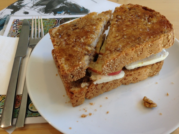 My delicious goat cheese, apple and walnut sandwich with honey on the outside.