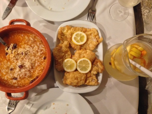 A delicious traditional Portuguese dinner of beans and rice, cod and white sangria.